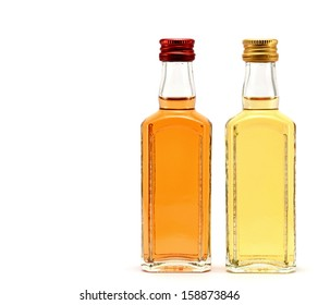 glass bottles filled with by different liquids