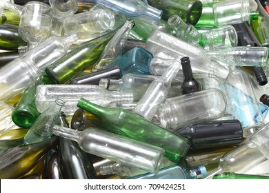 Glass bottles inside a glass recycling container