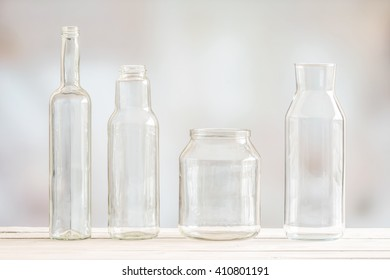 Glass bottles on a row on a wooden table