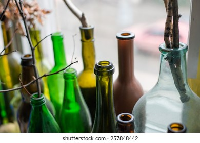 of glass bottles on the window