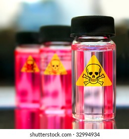 glass bottles with red liquid and skull sticker
