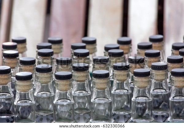 Glass bottles, several bottles in a box, necks with a bottle stopper.