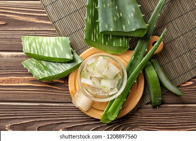Glass bowl with aloe vera on wooden table
