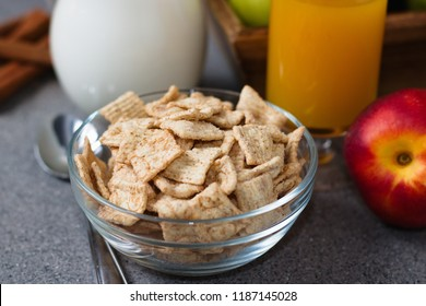 Glass bowl of breakfast cereal with cinnamon flavour