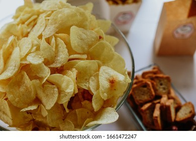 glass bowl with chips for salty table.  birthday party food