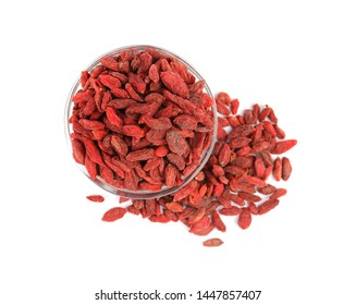 Glass bowl with dried goji berries on white background, top view