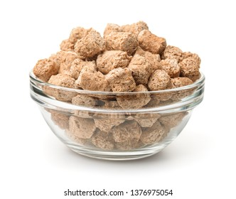 Glass bowl of extruded oats bran pellets isolated on white