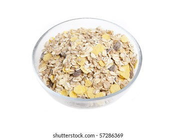 Glass bowl filled with muesli on white