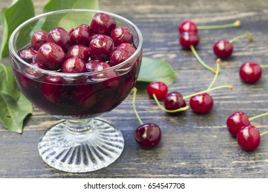 Glass bowl full of juicy cherry compote