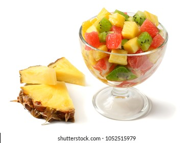 Glass bowl of healthy citrus fruit salad isolated on white background