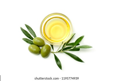 Glass bowl with olive oil, big olives and olive leafs. Close-up, isolated on white background