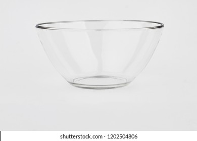 Glass bowl on white background. Empty glass dish. Dish ware for salad.