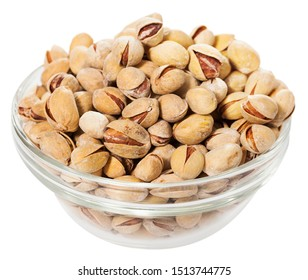 Glass bowl with unshelled roasted salted pistachios. Isolated over white background
