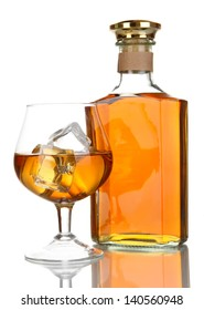 Glass of brandy and bottle isolated on white