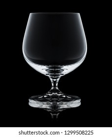 glass for brandy on black background