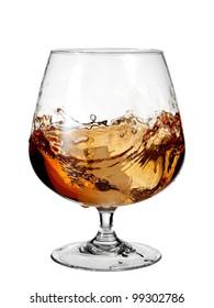 Glass with brandy plash