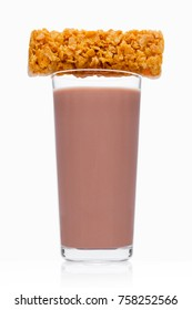 Glass of breakfast chocolate milk with cereal bar on white background