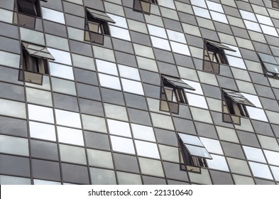 Glass building with open windows.