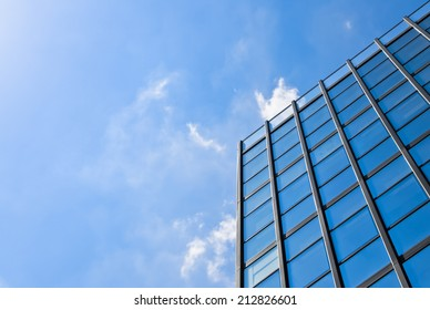 Glass building with reflection of the sky showing new perspectives and optimism