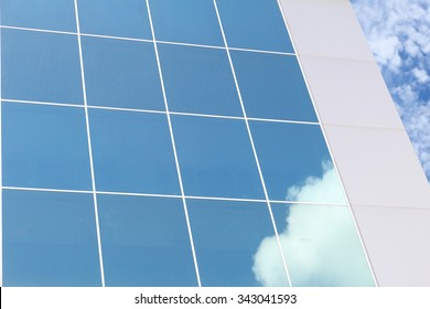 glass building and white cloud