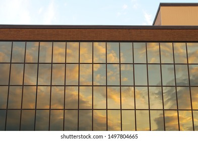 glass building yellow sky reflections office finance tower