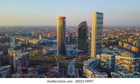 Glass buildings in Europe City Life. Aerial view of modern architecture of office buildings in new city districts. the drone shoots at three towers. Milan, Italy, June 2021: