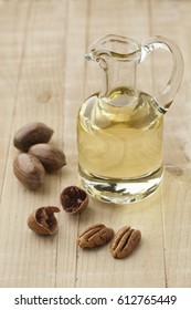 Glass can with pecan oil and nuts