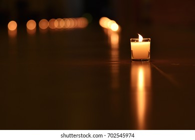A glass candle with blur candle light line