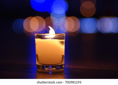 Glass candle with colorful bubble background