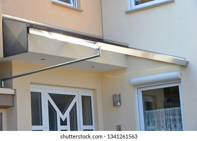 Glass Canopy with Frame, Rain-Gutter and rain pipe at a residential Building
