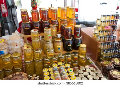 Glass cans with different types of honey