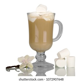 Glass with cappuccino, near pieces of marshmallow, vanilla and Orchid flower isolated on white