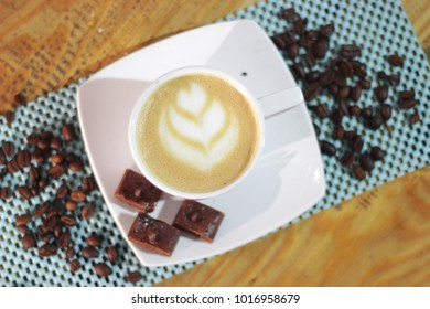 a glass of cappucino and brownies visible from above
