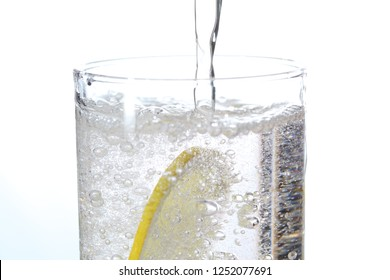 a glass of carbonated drink in a white background