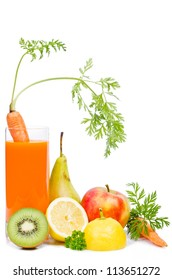 a glass with carrot juice and fruit before white background