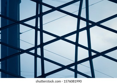 Glass ceiling panels. Close-up of minimalist business building interior fragment. Structural glazing. Abstract modern architecture background with hi-tech geometric structure of girders and windows.