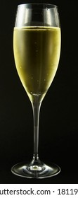Glass of champagne against a black background - closeup