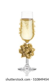 Glass of champagne with christmas decoration gift on white isolated