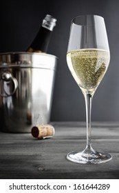 Glass of Champagne and Cooler, selective focus