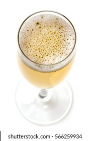 glass of champagne isolated on white background, top view, selective focus
