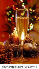 glass of champagne over new year decoration