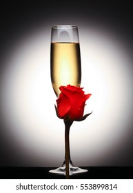 Glass champagne with red rose