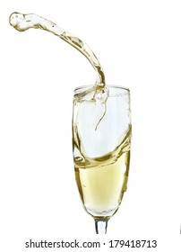 Glass of champagne with splash, isolated on white