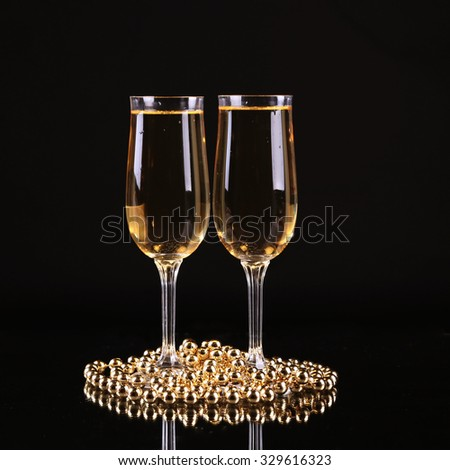 glass of champagne with splash on black background champagnenew years eve