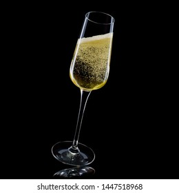 Glass for champagne with splashes on black background. Isolated with clipping path