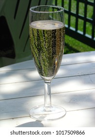 Glass of champagne in the sun