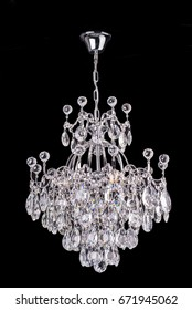glass chandelier isolated over black background