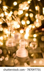 Glass chess with bokeh effect