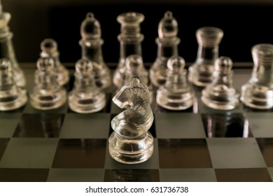 Glass Chess piece on board