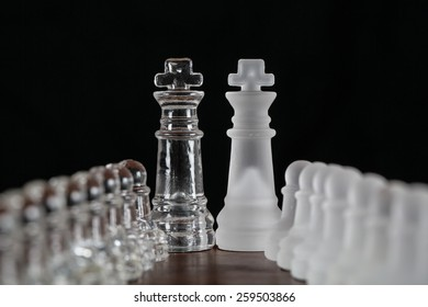 Glass chess pieces leading to the kings.
